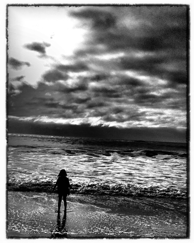 Little girl at oceans edge